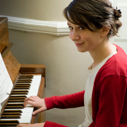 Teen playing piano